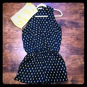 Navy romper with yellow accents.